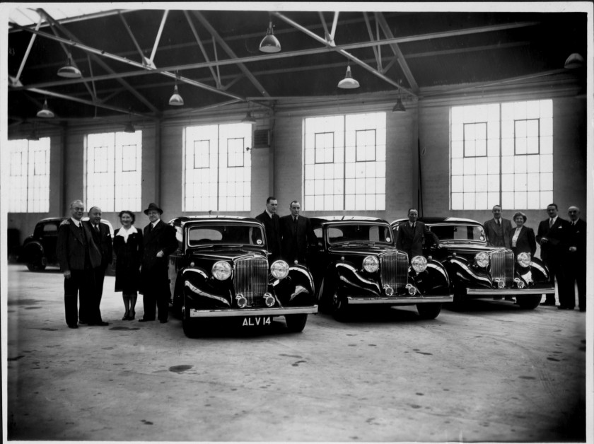 The photograph was especially posed in defiant mode on November 11th, 1946 (exactly six years to the day of the Coventry Blitz ). It shows Alvis Ltd.'s three premier regional Agents taking delivery of the first completed production Mulliners saloons. W H Bates, of London's Brooklands of Bond Street is about to spirit away 20573, Mulliners M 1 , which would become registered as JLP 344. Keith Elliott, Galt's of Glasgow has been allocated 20589, Mulliners M3, which would shortly wear the Galt dealership registration G 1. Then there is W.J. Hanna, Hanna's of Belfast, 20655, Mulliners M 5, subsequently GZ 6178. The car in the far background might very well therefore be Mulliners M2 , chassis 20553, exported to Switzerland on January 15th 1947.