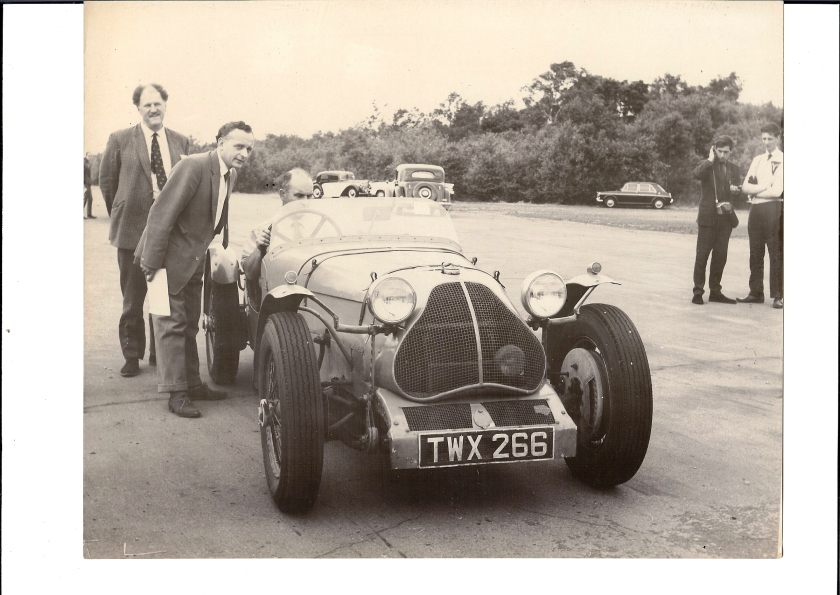 Can you name the people, the car, the place and the date? At least one current AOC official is in the picure.