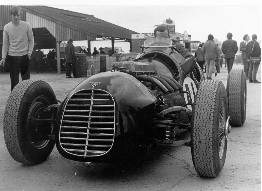 This is the Clinkard 4.3 single seater special with Clink at the wheel. The car was still supercharged at this stage. I believe the blower has now been removed and it has conventional SU carburation. It would be interesting to know more of the parts used for its construction. The front suspension bottom arms are standard prewar Alvis with coil spring supports added.